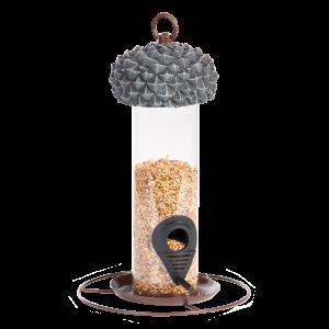 lasinen siilon mallinen lintulauta, jossa tammenterhon näköinen harmaa hattu
