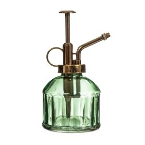 vihreä lasinen sumutinpullo